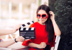 72727256 - actress with oversized sunglasses shooting movie scene
